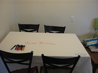 We have a birthday tablecloth for each of our children. The birthday tablecloth gets put on the table on their birthdays and new birthday messages are written using fabric markers!     I love reading the special messages every year and it makes their day extra special when they enter the kitchen and see their birthday tablecloth on the table!  cute idea!