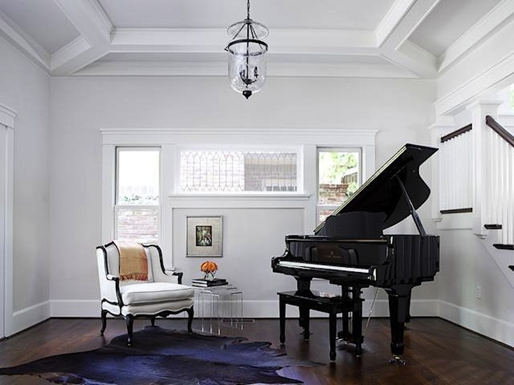 Simple luxury with a piano and a black and white wingback chair. (3522 Gillon Avenue, Highland Park)