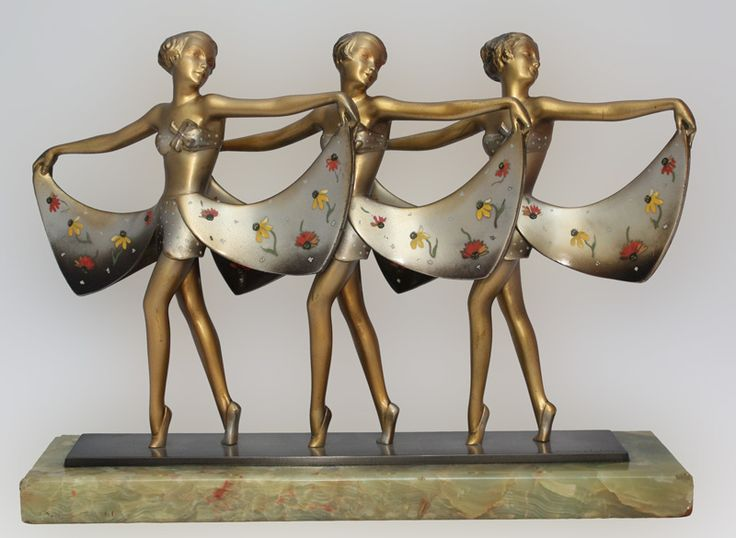 An extremely rare and stunning Art Deco Austrian bronze figure group by Lorenzl, circa 1930, depicting a trio of dancers, with a silvered, gold and enamelled cold-painted finish (by Crejo), mounted on an onyx marble plinth- 21cm high 29cm wide signed Lorenzl, Wien in bronze socle, Crejo in enamel