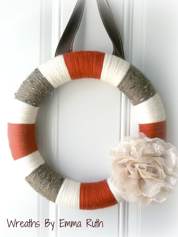 Not loving the lace flower, but I like the color blocking. Modern Fall Stripe Yarn Wreath in Rustic Red by WreathsByEmmaRuth, $30.00