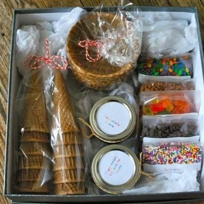 I picked up some waffle cone bowls, sugar cones and assorted candies and repackaged everything in clear cello bags with colourful labels and bakers twine. I then made some homemade chocolate sauce, jarred it, and packaged everything together in a little gift box.  It was so simple to put together and the recipients were thrilled, which was the whole point.