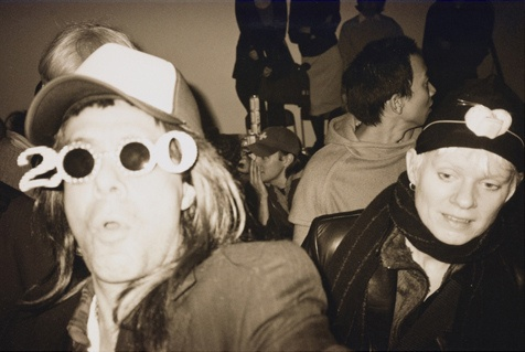 Citation: Unidentified partygoers, 2000 Nov. 30. Photographer unknown. Colin de Land collection, Archives of American Art, Smithsonian Institution.