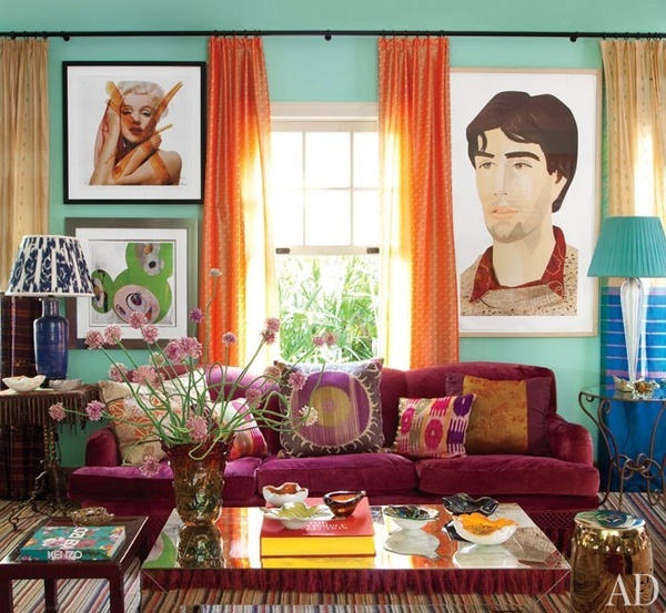 Sea-foam colored walls, a purple sofa and multi-colored rug, ... | A&D