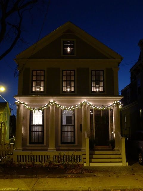 Night Time: Swags on Columns. Candles in Windows.    Credit: An Urban Cottage: Christmas