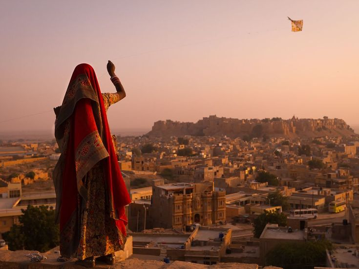 """This young girl's kite soared above Jaisalmer. Mere paper, stick, and string … It seemed to carry her daydreams to the winds."""