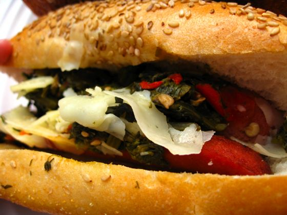 ... dogs are topped with broccoli rabe, longhots, and sharp provolone on a