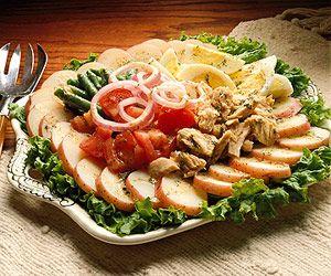This low-calorie recipe for salade nicoise (sah-LAHD nee-SWAHZ) uses ...