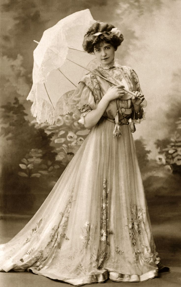 Victorian era gown with parasol vintage hair makeup for Victorian style