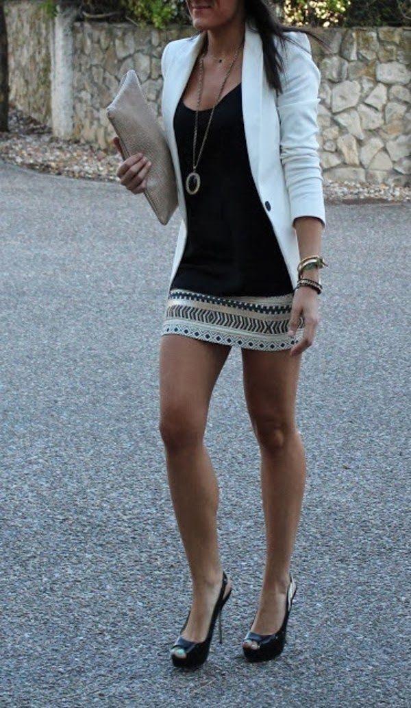 white blazer, black blouse, mini skirt and cream purse
