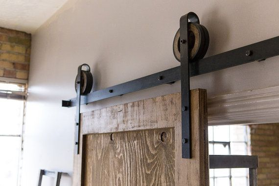 Sliding barn doors rustic sliding barn door hardware for Rustic hardware barn doors