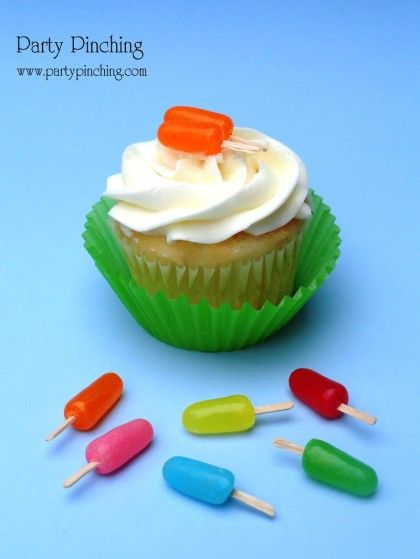little popsicle cupcake toppers made from flat toothpicks pushed into Mike and Ike candies. >> Adorable!