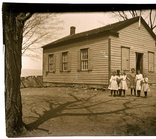 Girls in front of one-room school house :: Historic Huguenot Street