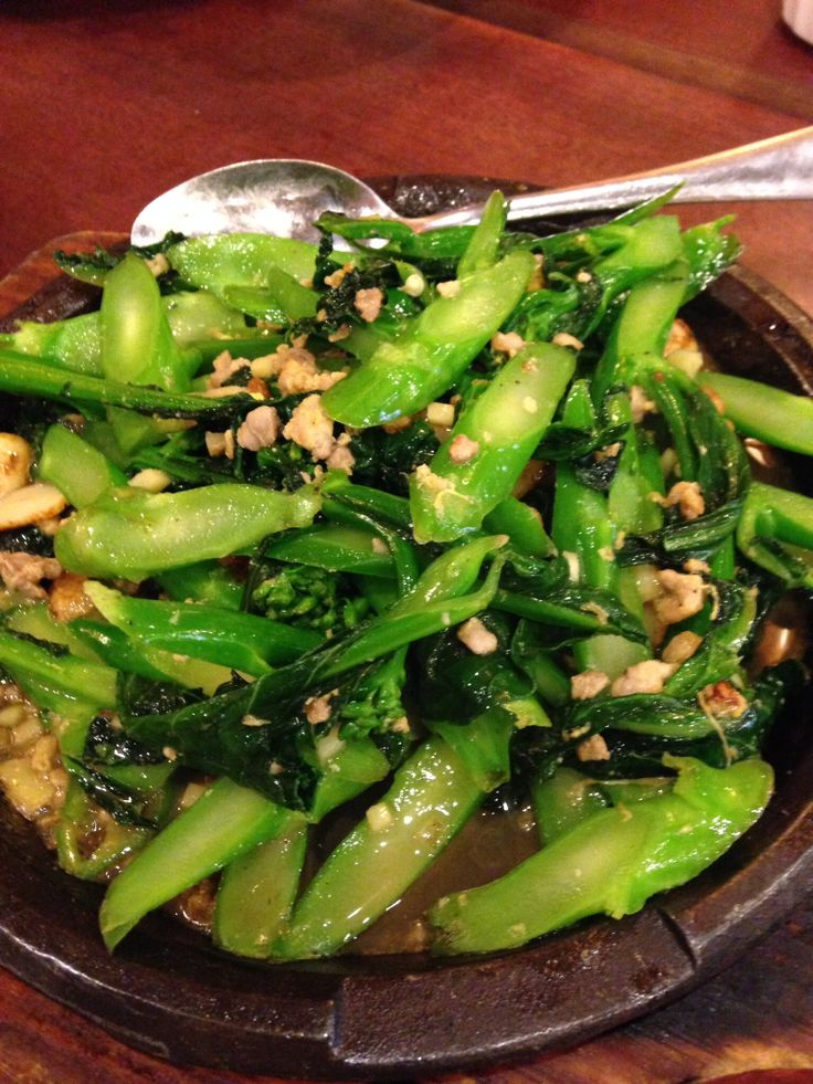 Chinese broccoli lightly sautéed in Cantonese sauce at Congee Village ...