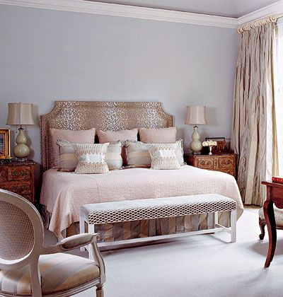 Drapery hardware can impact the look of curtains as much as the panels themselves. These bone-white rod and rings underscore this bedroom's sophisticated mood.