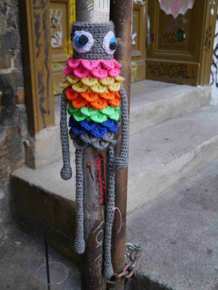 Amazing yarn bombing piece on scaffolding.