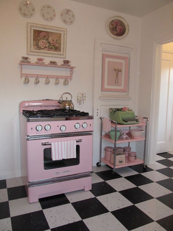 Retro pink stove and vintage pink cart...wish you could still get pink appliances. And love the black and white check floor too.