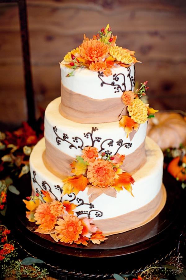 Three Tier Round Wedding Cake With Cascading Burlap and Flower Garland