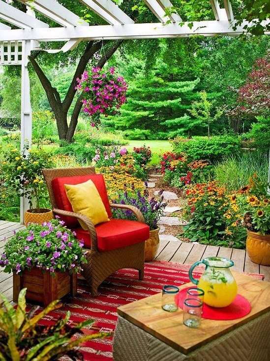 Beautiful Backyard Patios : Beautiful, Green Outdoor Patio with pops of red and yellow Area rug