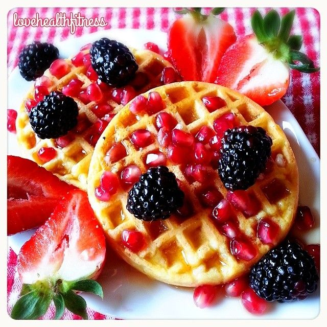 whole grain waffles with pomegranate, blackberries, strawberries ...