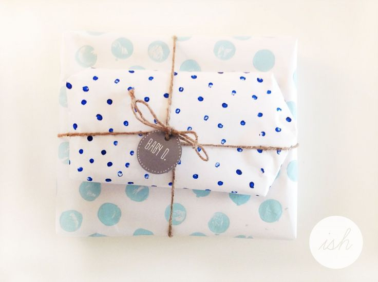 White kraft paper for both. Q-tip dots for small gift, wooden craft circle used to stamp larger dots.