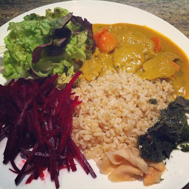 Japanese curry rice (カレーライス) served with brown rice, raw ...