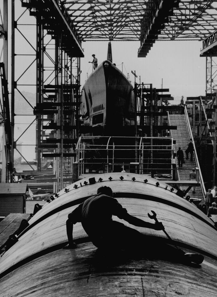 Man working on the hull of a U.S. submarine.