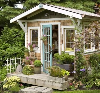 Cute potting shed with porch...would also make a nice retreat for reading!