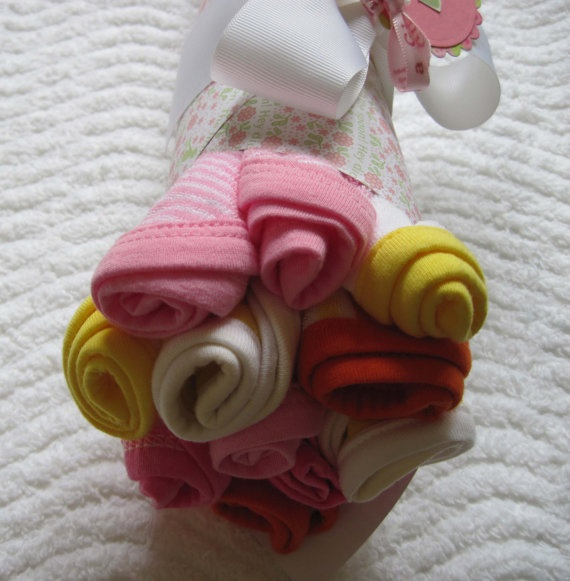 Baby washcloth bouquet put into painted plant pot for a more complete