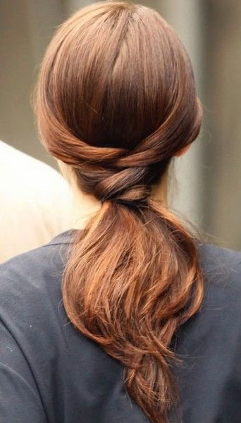 """Divide your hair into two parts. Take the top hair and make a loose ponytail which you loop through the parted center as described in the image caption. Then take the lower part of the hair, divide it into two parts and """"cross"""" over the rubberband from the top ponytail (to hide it), kind of lik tying a simple knot. Now fasten the ends of the lower part of the hair in the back of the rubberband either with a pin or two or just pry it into the rubberband."""