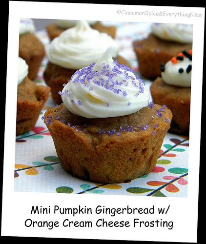 Pumpkin gingerbread muffins with orange cream cheese frosting