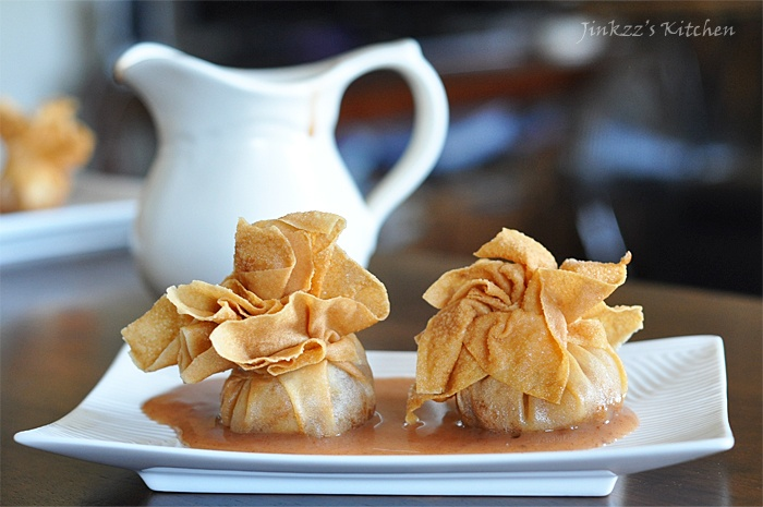 Apple, pear, and peach in a crispy wonton wrapper, served with warm ...