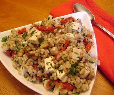 Warm farro salad with feta, sun-dried tomatoes, and ricotta salata.