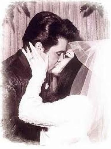 Elvis, Priscilla, and a small group fly out of Palm Springs in a rented jet for Las Vegas, arriving around 3:20 A.M., and the rest of the gang arrives later. Elvis, Priscilla and Joe go to the County Clerk's office by limo and get a marriage license, then pile back into the waiting limo and drive to the Aladdin Hotel, where they are married in a civil ceremony at 9:41 A.M. by a justice of the Nevada Supreme Court, David Zenoff.