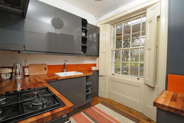 grey/orange kitchen