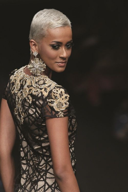 ... Love the striking contrast between her caramel skin and platinum hair