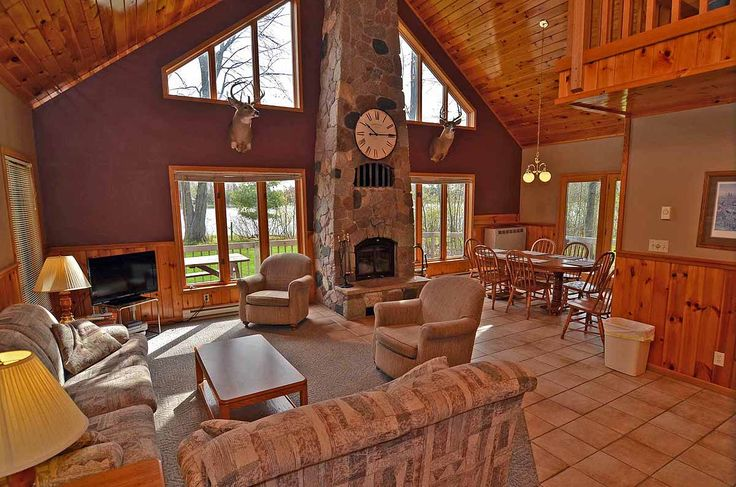 Includes an open great room that rises to a vaulted knotty pine