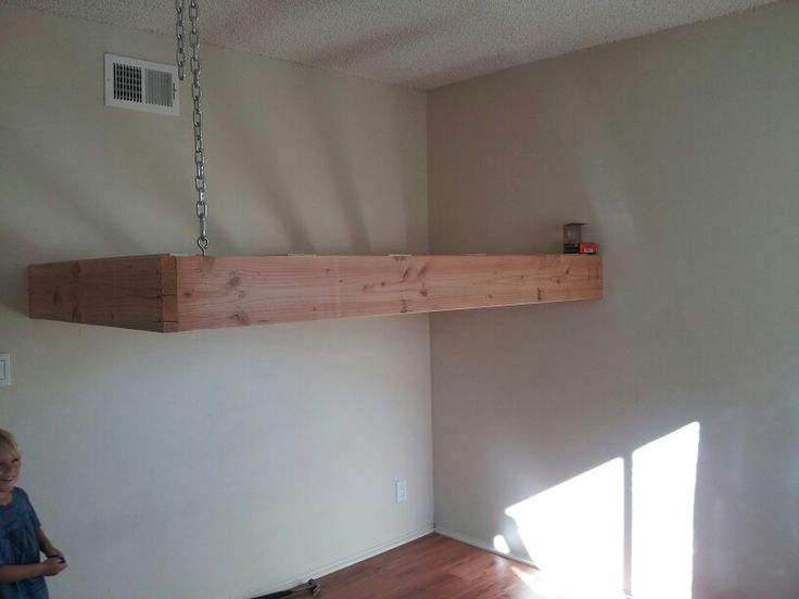 Suspended loft bed creating more space for a small shared for Suspended bed plans