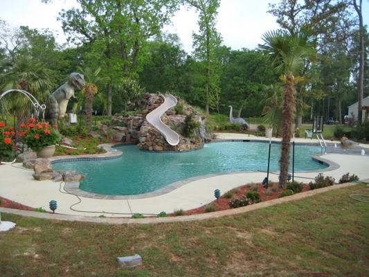 Pool grotto slide beach entry pool designs patios pinterest Beach entry swimming pool designs