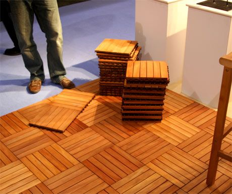 Outdoor wood tiles cover an ugly concrete patio with these for a feet