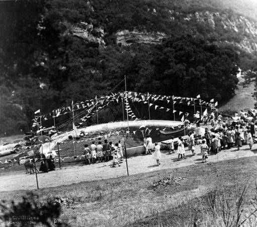 Fred Solomon sponsored an annual outting for L. A. Orphans' in at his property in Topanga in the 1920s. This image shows the swimming hole with small boats floating within it. Topanga Historical Society. San Fernando Valley History Digital Library.