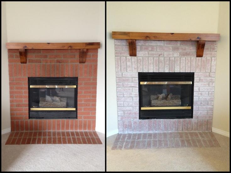 white wash brick fireplace