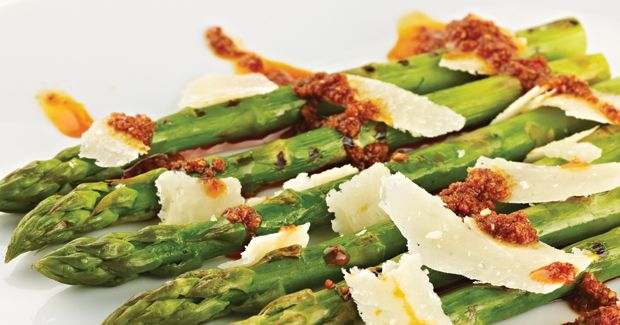 grilled asparagus with mojo picon sauce and shaved manchego cheese
