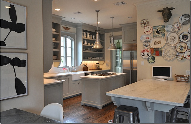 sally wheat kitchen island and plate wall via cote de texas by Mudrick