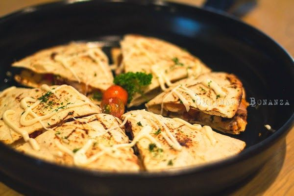 ... grilled chicken, mexican salsa, jalapeno, mozzarella & yellow cheddar