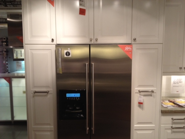 cabinets around fridge instead of stand alone pantry not