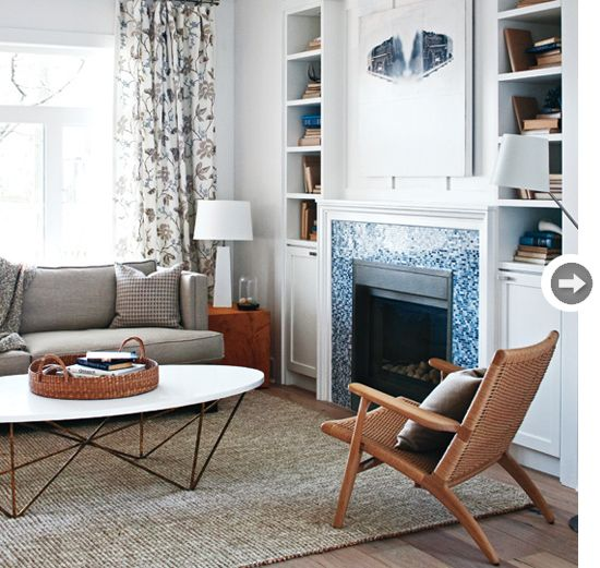 Living room such as the danish modern chairs floral drapes and