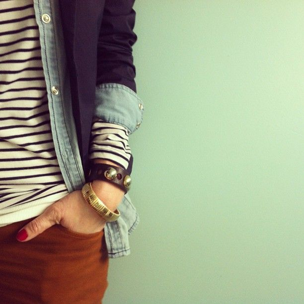 Black and white striped shirt, chambray or denim button-up shirt, navy blazer, burnt orange jeans