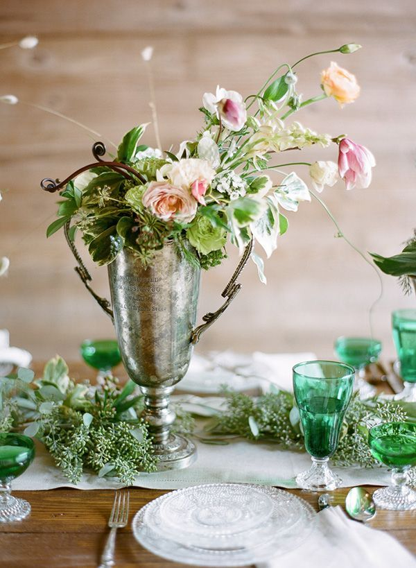 Dress It Down: Flowers - mix and match centerpiece sizes and vintage silver containers.