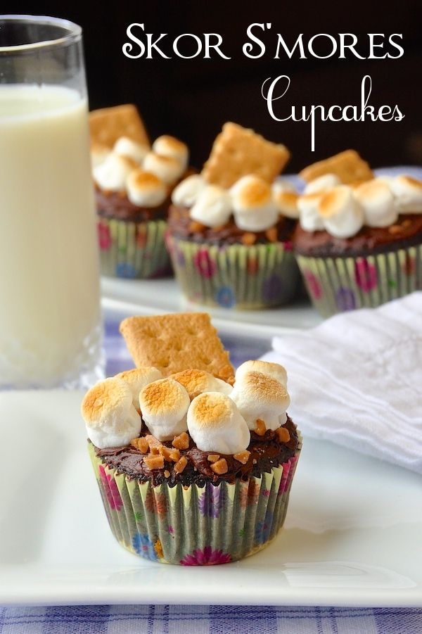 Skor S'mores Cupcakes - my teen daughter baked these amazing chocolate cupcakes with chocolate chips, marshmallows and Skor toffee chips in a delicious combination of flavors perfect for celebration parties that include all ages.