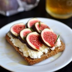 Sandwich with ricotta cheese, honey, fresh fig slices and rosemary ...